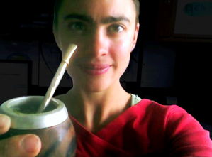 yerba mate tea served in gourd with bombilla straw.
