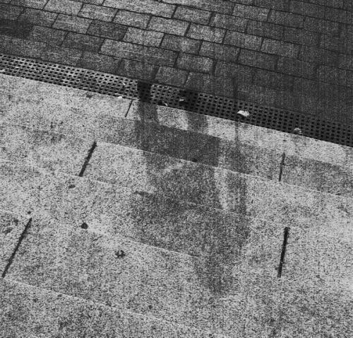 "The ""shadow"" of a Hiroshima victim, permanently etched into stone steps, after the 1945 atomic bomb: you can tell that it was a elderly human being by the use of the cane in his right hand."