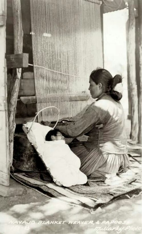 Navajo (Dine) blanket weaver & child. 1920. Photo by Mullarky Photo.