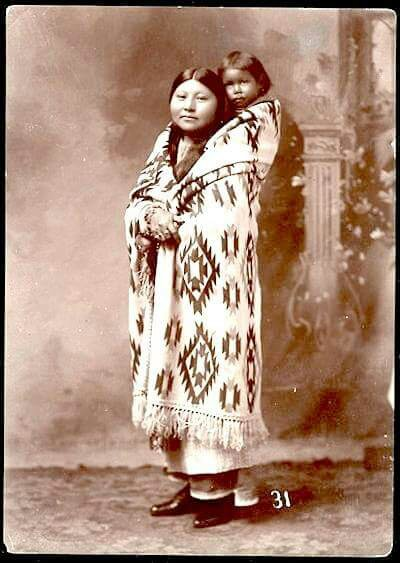 Comanche mother and child. ca. 1900.