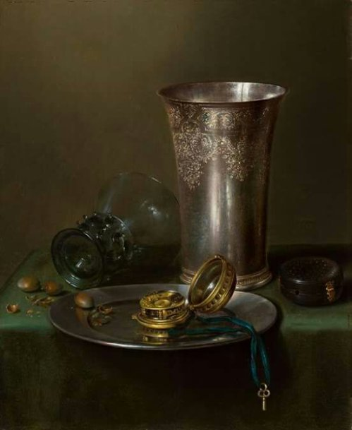 Willem Claeszoon Heda (Dutch, 1594-1680). A still life with a silver goblet and a watch on a pewter plate