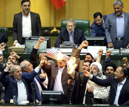 Iranian lawmakers burn a paper U.S. flag and a copy of the nuclear deal document as they chant slugans againts U.S. at the parliament in Tehran, Iran, Wednesday, May 9, 2018.  (AP)Wednesday, 09 May 2018 7:22 AMRead Newsmax: Iran Lawmakers Burn US Flag in Parliament Urgent: Do you approve of Pres. Trump's job performance? Vote Here Now!